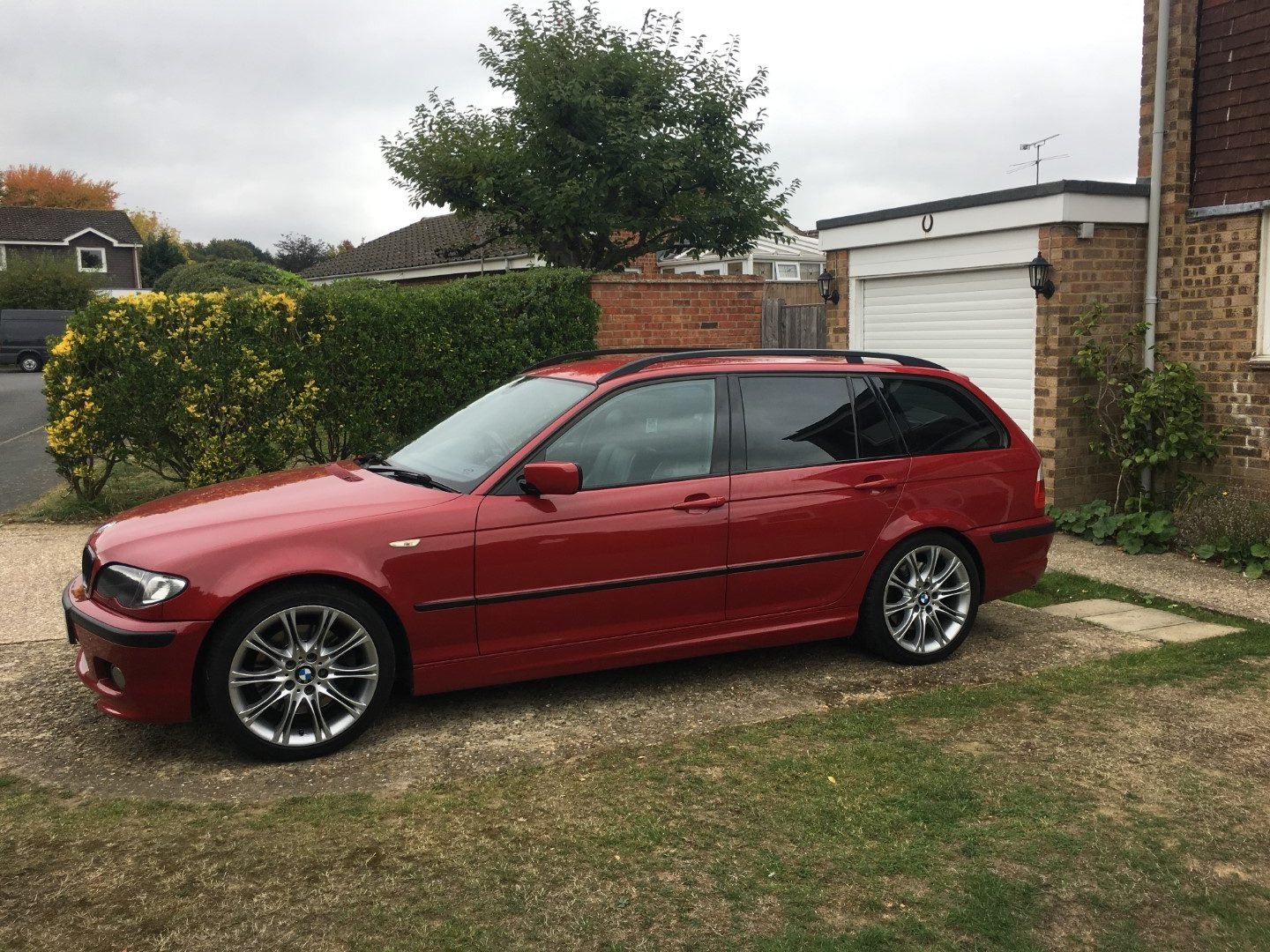 Imola Red 330d with 35% privacy glass